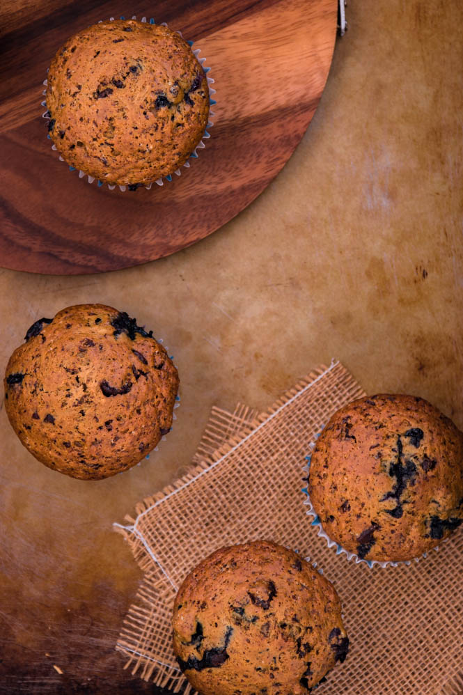 blueberry chocolate muffins and wooden board