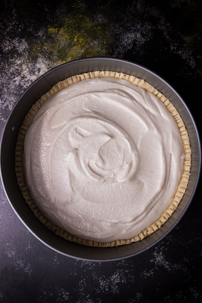 springform pan with pie crust and cream filling