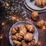 rugelach cookies on a plate, flowers, lights