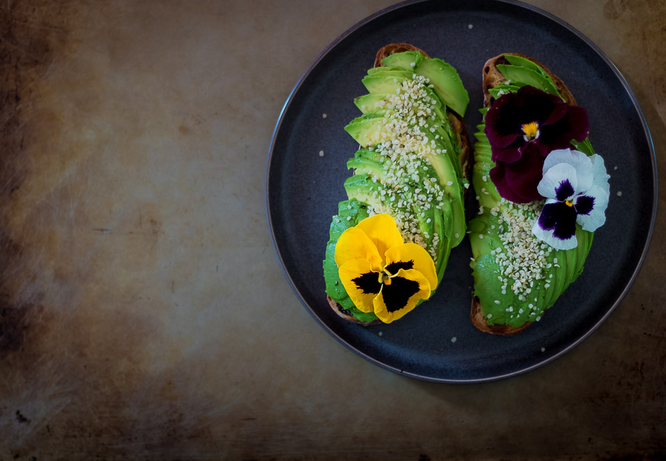 two avocado toasts on a plate