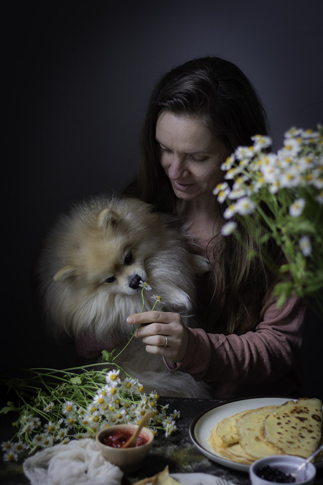 self portrait with a dog and flowers