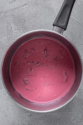 saucepan with dry hibiscus infused milk