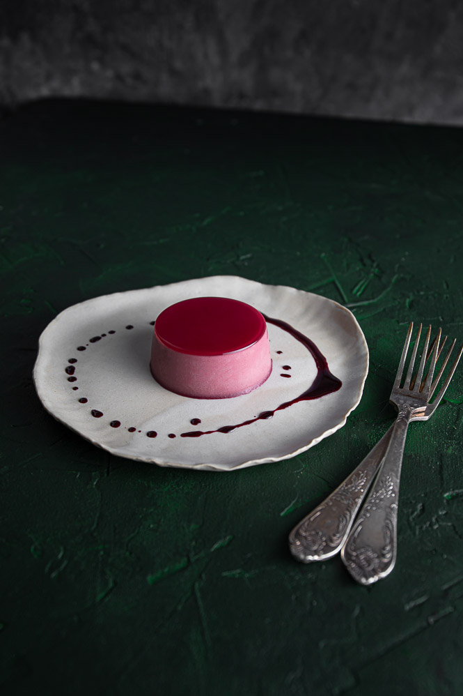 Hibiscus Panna Cotta on a plate. Two forks.