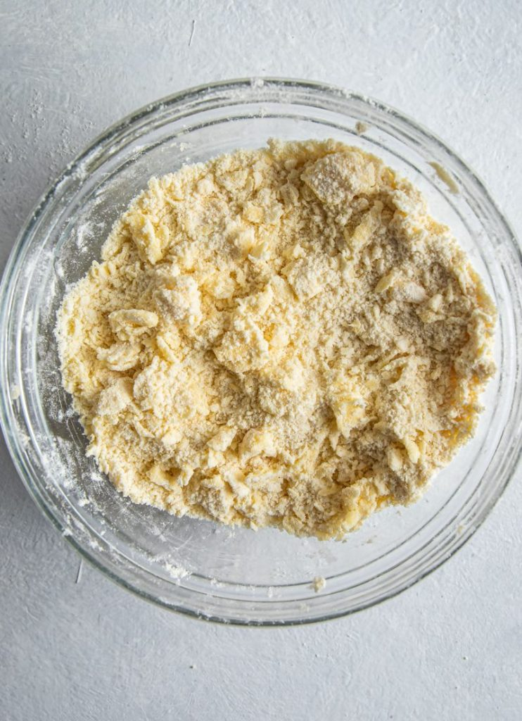 flour and butter mixed together in a glass bowl.