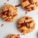Baked cookies drizzled with dulce de leche.