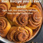 Baking dish with cinnamon rolls. Cinnamon sticks next to the dish.
